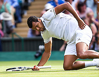 London, England, 6 th July, 2016, Tennis,  Wimbledon, Men's quarterfinal    Jo-Wilfried Tsonga (FRA) falls to the grass in his match against Andy Murray (GBR) <br /> Photo: Henk Koster/tennisimages.com