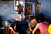 Korean tourists sit around and wait for glass of lassi (yogurt drink) at The Blue Lassi shop in the ancient city of Varanasi in Uttar Pradesh, India. Photograph: Sanjit Das/Panos