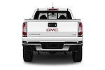 Straight rear view of 2016 GMC Canyon 2WD SLE Extended Cab 4 Door Pick-up Rear View  stock images