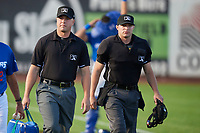 Umpires Jake Bruner and Colin Baron walk out to Lindquist Field on August 28, 2017 in Ogden Utah as the Idaho Falls Chukars faced the Ogden Raptors. Ogden defeated Idaho Falls 7-1. (Stephen Smith/Four Seam Images)