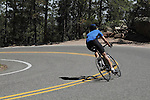 Person biking downhill on Lookout Mountain Road west of Denver, Colorado. .  John leads private photo tours in Boulder and throughout Colorado. Year-round.