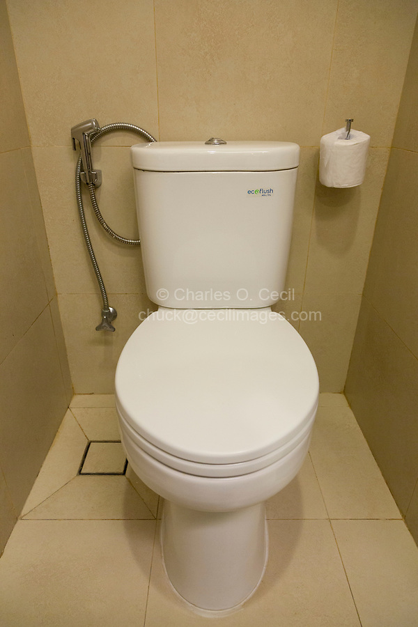Yogyakarta, Indonesia.  Toilet with Paper for Western (European/American) Users, or Water Hose for non-Western (Islamic, Asian, Third World) Users.