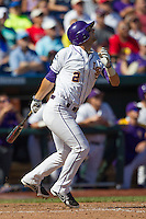 Louisiana State pinch hitter Tyler Moore (2) follows through on his swing against the North Carolina Tar Heels during Game 7 of the 2013 Men's College World Series on June 18, 2013 at TD Ameritrade Park in Omaha, Nebraska. The Tar Heels defeated the Tigers 4-2, eliminating LSU from the tournament. (Andrew Woolley/Four Seam Images)