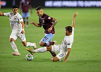 CARSON, CA - SEPTEMBER 19: Jonathan dos Santos #8 of the Los Angeles Galaxy slide tackles Andre Shinyashiki #99 of the Colorado Rapids during a game between Colorado Rapids and Los Angeles Galaxy at Dignity Heath Sports Park on September 19, 2020 in Carson, California.