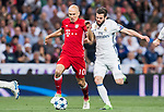 Arjen Robben (l) of FC Bayern Munich competes for the ball with Nacho Fernandez of Real Madrid during their 2016-17 UEFA Champions League Quarter-finals second leg match between Real Madrid and FC Bayern Munich at the Estadio Santiago Bernabeu on 18 April 2017 in Madrid, Spain. Photo by Diego Gonzalez Souto / Power Sport Images