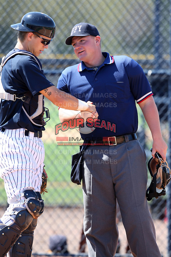 March 26, 2010:  Home plate umpire Gus Curtis shakes hands with catcher Kyle Perkins during Spring Training at the Yankees Minor League Complex in Tampa, FL.  Photo By Mike Janes/Four Seam Images