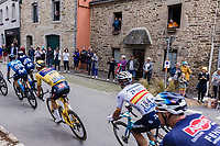yellow jersey, Mathieu van der Poel (NED/Alpecin Fenix) in the bunch rolling through a town<br /> <br /> Stage 3 from Lorient to Pontivy (183km)<br /> 108th Tour de France 2021 (2.UWT)<br /> <br /> ©kramon