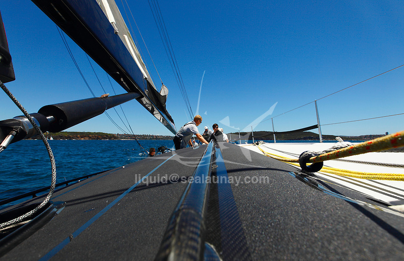 Onboard Alfa Romeo during a test sail in Sydney, Australia in preparation for the Rolex Sydney to Hobart 2009. .'Alfa Romeo', the second yacht built by New Zealand skipper and owner, Neville Crichton, to carry the name of the Italian car maker, was penned by leading American yacht designers, Reichel/Pugh and built in Sydney by McConaghy Boats.