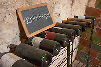old bottles in the cellar chalk board mas du notaire rhone france