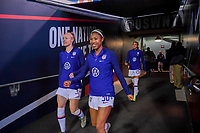 JACKSONVILLE, FL - NOVEMBER 10: Becky Sauerbrunn #4 and Margaret Purce #30 of the United States walk out on to the field to warm up during a game between Costa Rica and USWNT at TIAA Bank Field on November 10, 2019 in Jacksonville, Florida.