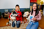 Ríann and Regan Zhang at home with their rescue dogs Riley and Moe, who they turned into superhero characters in their book and all proceeds from sales, will go to the Sera Huskeys Charity.