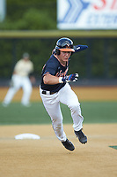 Jake McCarthy (31) of the Virginia Cavaliers takes off for third base against the Wake Forest Demon Deacons at David F. Couch Ballpark on May 19, 2018 in  Winston-Salem, North Carolina. The Demon Deacons defeated the Cavaliers 18-12. (Brian Westerholt/Four Seam Images)