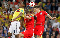 MOSCU - RUSIA, 03-07-2018: Yerry MINA (Izq) jugador de Colombia disputa el balón con Eric DIER (C) y John STONES (Der) jugadores de Inglaterra durante partido de octavos de final por la Copa Mundial de la FIFA Rusia 2018 jugado en el estadio del Spartak en Moscú, Rusia. / Yerry MINA (L) player of Colombia fights the ball with Eric DIER (C) and John STONES (R) players of England during match of the round of 16 for the FIFA World Cup Russia 2018 played at Spartak stadium in Moscow, Russia. Photo: VizzorImage / Julian Medina / Cont