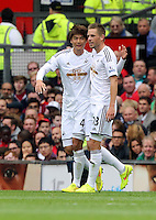 Pictured L-R: Ki Sung Yueng of Swansea celebrating his opening goal with team mate Gylfi Sigurdsson. Saturday 16 August 2014<br />