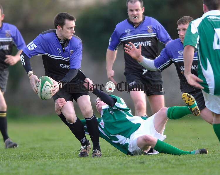 Kilrush's Michael Mc Guire is tackled by Richmond's Niall Phelan  during the Webb Cup final at Ennis RFC grounds. Photograph by John Kelly.