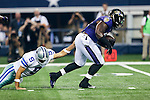 Dallas Cowboys quarterback Tony Romo (9) and Baltimore Ravens outside linebacker Courtney Upshaw (91) in action during the pre-season game between the Baltimore Ravens and the Dallas Cowboys at the AT & T stadium in Arlington, Texas. Baltimore defeats Dallas  37-30.