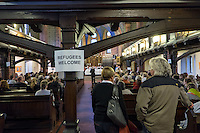 Am Montag den 7. April in Berlin-Adlershof eine Informationsveranstaltung zu einer geplanten Fluechtlingsunterkunft im Stadtteil statt. In einer Kirche waren Befuerworter und Gegner der Unterkunft versammelt, waehrend draussen ca. 20 Neonazis der NPD aus Berlin und Brandenburg, Hooligans des BFC-Dynamo und ca. 5 Personen die sich als Anwohner bezeichneten eine Kundgebung gegen gegen Auslander abhielten. Etwa 30-40 Menschen protestierten, einige hundert Meter enfernt und abgeschirmt von der Polizei, gegen die Kundgebung der Neonazis.<br /> 7.4.2014, Berlin<br /> Copyright: Christian-Ditsch.de<br /> [Inhaltsveraendernde Manipulation des Fotos nur nach ausdruecklicher Genehmigung des Fotografen. Vereinbarungen ueber Abtretung von Persoenlichkeitsrechten/Model Release der abgebildeten Person/Personen liegen nicht vor. NO MODEL RELEASE! Nur fuer Redaktionelle Zwecke. Don't publish without copyright Christian-Ditsch.de, Veroeffentlichung nur mit Fotografennennung, sowie gegen Honorar, MwSt. und Beleg. Konto: I N G - D i B a, IBAN DE58500105175400192269, BIC INGDDEFFXXX, Kontakt: post@christian-ditsch.de<br /> Bei der Bearbeitung der Dateiinformationen darf die Urheberkennzeichnung in den EXIF- und  IPTC-Daten nicht entfernt werden, diese sind in digitalen Medien nach §95c UrhG rechtlich geschuetzt. Der Urhebervermerk wird gemaess §13 UrhG verlangt.]
