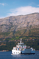 The car and passenger ferry between Orebic and Korcula, mountain in the background Mount Sveti Ilija mountain. Orebic town, holiday resort on the south coast of the Peljesac peninsula. Orebic town. Peljesac peninsula. Dalmatian Coast, Croatia, Europe.