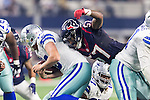 Dallas Cowboys quarterback Dustin Vaughan (10) and Houston Texans inside linebacker Justin Tuggle (57) in action during the pre-season game between the Houston Texans and the Dallas Cowboys at the AT & T stadium in Arlington, Texas.