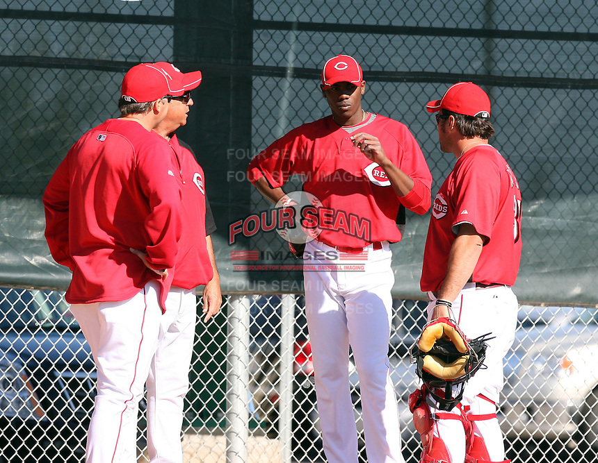 Aroldis Chapman, Cincinnati Reds pitcher in his first season after defecting from his native Cuba, pitches a bullpen session at the Reds training facility in Goodyear, AZ - 03/14/2010. Chapman discusses the session with Reds pitching coaches Bryan Price and Tony Fossas and catcher Corky Miller..Photo by:  Bill Mitchell/Four Seam Images.