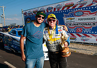 Sep 2, 2019; Clermont, IN, USA; NHRA funny car driver John Force celebrates with photographer Mark Rebilas after winning the US Nationals at Lucas Oil Raceway. Mandatory Credit: Gary Nastase