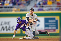 Georgia Bulldogs second baseman Jess Posey #23 turns a double play during the Southeastern Conference baseball game against the LSU Tigers on March 22, 2014 at Alex Box Stadium in Baton Rouge, La. The Tigers defeated the Bulldogs 2-1. (Andrew Woolley/Four Seam Images)