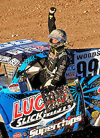 Nov. 6, 2010; Las Vegas, NV USA; LOORRS pro two unlimited driver Robby Woods celebrates after finishing second during round 13 at the Las Vegas Motor Speedway short course. Mandatory Credit: Mark J. Rebilas-