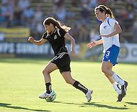 Tina DiMartino (left) runs the ball past Kelly Shmedes (3). Boston Breakers defeated FC Gold Pride 1-0 at Buck Shaw Stadium in Santa Clara, California on July 19, 2009.