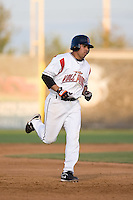July 7, 2009: Salem-Keizer Volcanoes' Juan Martinez rounds the bases after hitting a home run during a Northwest League game against the Tri-City Dust Devils at Volcanoes Stadium in Salem, Oregon.