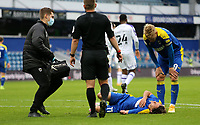 Ethan Chislett of AFC Wimbledon goes down injured during AFC Wimbledon vs Shrewsbury Town, Sky Bet EFL League 1 Football at The Kiyan Prince Foundation Stadium on 17th October 2020