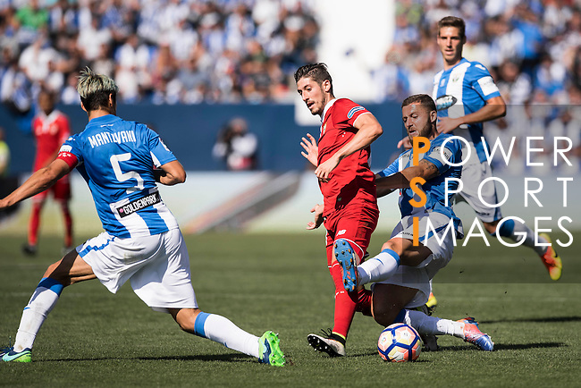 Sergio Escudero Palomo (r) of Sevilla FC fights for the ball with David Timor Copovi of Deportivo Leganes during their La Liga match between Deportivo Leganes and Sevilla FC at the Butarque Municipal Stadium on 15 October 2016 in Madrid, Spain. Photo by Diego Gonzalez Souto / Power Sport Images