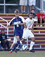 University of Rhode Island (URI) forward Thomas Lindroos (16) passes the ball as Boston College defender Stefan Carter (23) closes. Boston College defeated University of Rhode Island, 4-2, at Newton Campus Field, September 25, 2012.