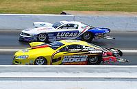 May 15, 2011; Commerce, GA, USA: NHRA pro stock driver Rodger Brogdon (near) races Larry Morgan during the Southern Nationals at Atlanta Dragway. Mandatory Credit: Mark J. Rebilas-
