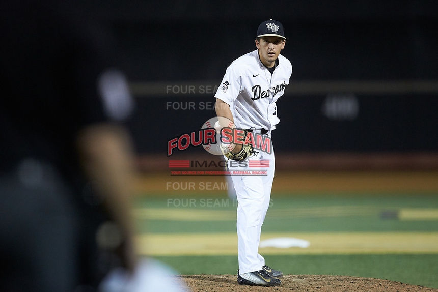 Wake Forest Demon Deacons relief pitcher Bobby Hearn (34) looks to his catcher for the sign against the North Carolina State Wolfpack at David F. Couch Ballpark on April 18, 2019 in  Winston-Salem, North Carolina. The Demon Deacons defeated the Wolfpack 7-3. (Brian Westerholt/Four Seam Images)