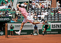 Paris, France, 28 May, 2017, Tennis, French Open, Roland Garros, Match on court Philippe Chatrier (centercourt) between Stephane Robert (FRA) foreground and Grigor Dimitrov (BUL)<br /> Photo: Henk Koster/tennisimages.com