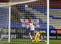 Bolton Wanderers' Antoni Sarcevic (right) chips Salford City's goalkeeper Vaclav Hladky only for his shot to sail over the crossbar<br /> <br /> Photographer Andrew Kearns/CameraSport<br /> <br /> The EFL Sky Bet League Two - Bolton Wanderers v Salford City - Friday 13th November 2020 - University of Bolton Stadium - Bolton<br /> <br /> World Copyright © 2020 CameraSport. All rights reserved. 43 Linden Ave. Countesthorpe. Leicester. England. LE8 5PG - Tel: +44 (0) 116 277 4147 - admin@camerasport.com - www.camerasport.com