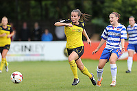 Watford's Megan Wynne chases the ball leaving Reading's Lauren Bruton looking on during the FAWSL2 match between Watford Ladies & Reading Ladies at Berkhamstead FC on Sunday August 10th 2014
