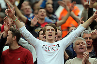 Pictured:Ecstatic Swansea supporters celebrating their team's win after the final whistle. Saturday 16 August 2014<br /> Re: Premier League Manchester United v Swansea City FC at the Old Trafford, Manchester, UK.