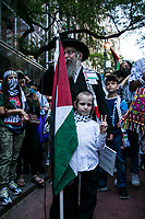NEW YORK, NY - JUNE 15: A pro-Palestinian Orthodox Jew speaks with a child during a large protest in New York on June 15, 2021. The solidarity action of hundreds of pro-Palestinians is a form of support against the attacks carried out by the Israeli government. At the same time, Palestinian Prime Minister Mohammad Shtayyeh says the new Israeli government is just as bad as the old one and condemns Naftali Bennett's announcements in support of Israeli settlements. That is why the demonstrations continue in different parts of the world. (Photo by Pablo Monsalve / VIEWpress via Getty Images