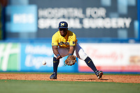 Michigan Wolverines second baseman Ako Thomas (4) fields a ground ball during a game against Army West Point on February 17, 2018 at Tradition Field in St. Lucie, Florida.  Army defeated Michigan 4-3.  (Mike Janes/Four Seam Images)