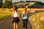 Two women walk on a path at Graham Oaks.