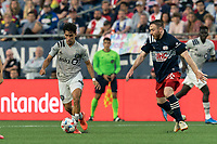 FOXBOROUGH, MA - JULY 25: Joaquin Torres #18 of CF Montreal dribbles during a game between CF Montreal and New England Revolution at Gillette Stadium on July 25, 2021 in Foxborough, Massachusetts.
