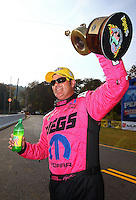 Oct 6, 2013; Mohnton, PA, USA; NHRA pro stock driver Jeg Coughlin Jr celebrates after winning the Auto Plus Nationals at Maple Grove Raceway. Mandatory Credit: Mark J. Rebilas-