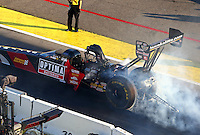 Aug 15, 2014; Brainerd, MN, USA; NHRA top fuel dragster driver J.R. Todd during qualifying for the Lucas Oil Nationals at Brainerd International Raceway. Mandatory Credit: Mark J. Rebilas-