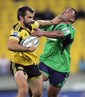 Conrad Smith hands off Ma'afu Fia during the Super 15 rugby match between the Hurricanes and Highlanders at Westpac Stadium, Wellington, New Zealand on Saturday, 17 March 2012. Photo: Dave Lintott / lintottphoto.co.nz