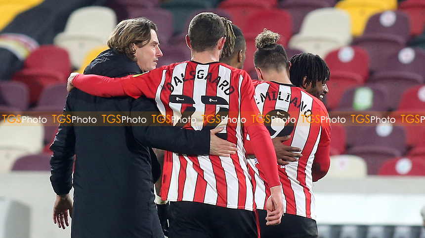Brentford Manager, Thomas Frank, walks off the pitch at the final whistle with his arm around Henrik Dalsgaard, scorer of their opening goal during Brentford vs AFC Bournemouth, Sky Bet EFL Championship Football at the Brentford Community Stadium on 30th December 2020
