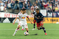 FOXBOROUGH, MA - JUNE 23: Sean Davis #27 of New York Red Bulls looks to pass as Brando Bye #15 of New England Revolution closes during a game between New York Red Bulls and New England Revolution at Gillette Stadium on June 23, 2021 in Foxborough, Massachusetts.