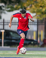 Malden, Massachusetts - July 8, 2018:  In a National Premier Soccer League (NPSL) match, Boston City FC (red/blue) defeated Greater Lowell NPSL FC (white), 3-2, at Brother Gilbert Stadium on Donovan Field.