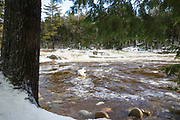 Lower Falls of the Swift River in Albany, New Hampshire USA after heavy rains during the winter months. These falls are located along the Kancamagus Highway (route 112) which is one of New England's scenic byways.