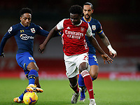 17th December 2020, Emirates Stadium, London, England;  Arsenals Bukayo Saka  challenges with Southamptons Kyle Walker-Peters during the English Premier League match between Arsenal and Southampton